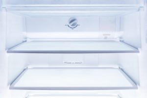 istock 834598830 scaled 300x200 inside of clean and empty refrigerator with shelves, good background for health or diet concept